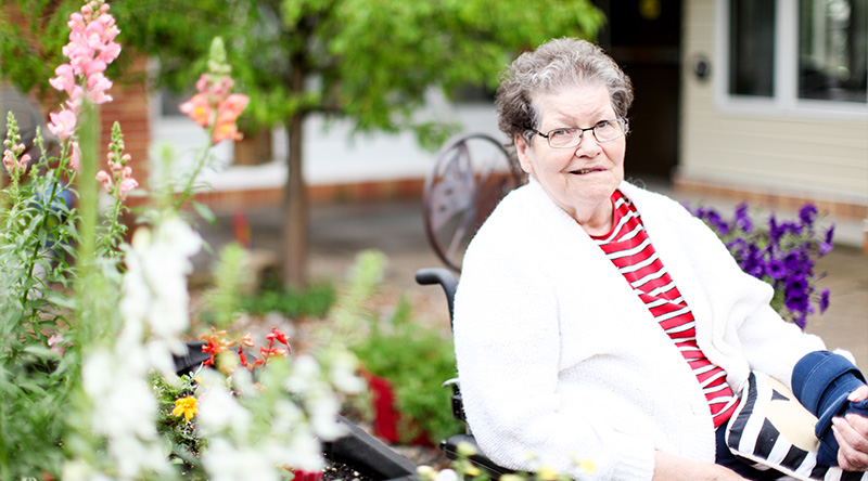 A resident enjoys the outdoors at our long term care facility