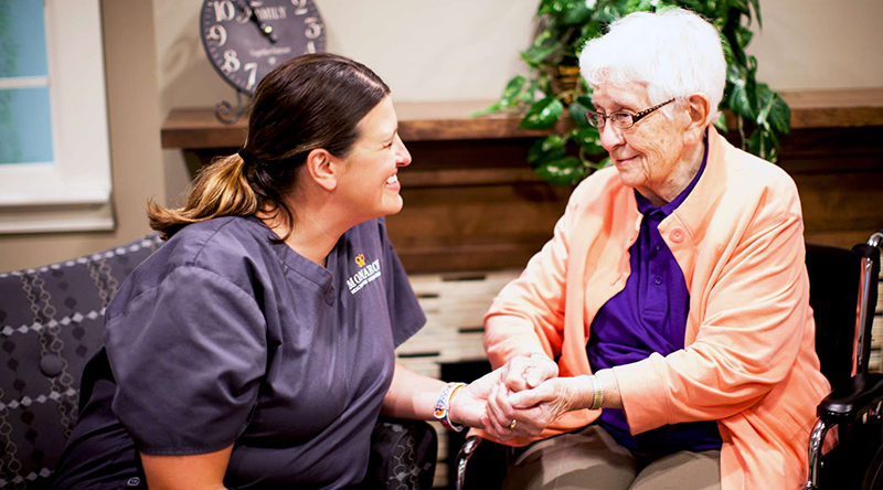 Resident and staff are chatting in our specialty services programs.