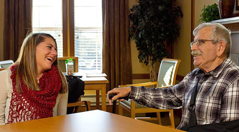 Resident in skilled nursing visits with a guest