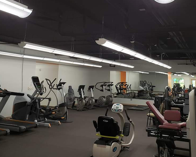 Full Gym in the M-Power Wellness Center. Select from many equipment options; including treadmills, Nustep, recumbent bikes, elliptical, free weights, and strength training machines.