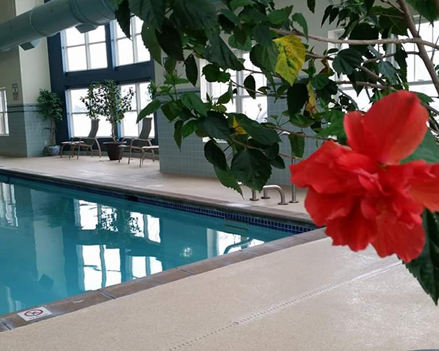 Heated Indoor Pool featuring a three-lane warm water lap pool. Members enjoy both instructed classes and open swim.